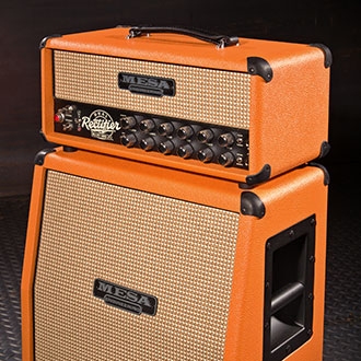 Recto-Verb Head with 1x12 Slant Mini Rectifier Extension Cab in Orange Vinyl, Cream and Tan Grille and Black Piping and Corners.