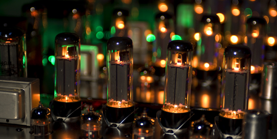 A rack of tubes glowing nicely at the burn-in stage of amp testing.