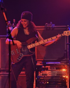 Rhonda Smith smiles big under the stage lights with the bass duty under control.