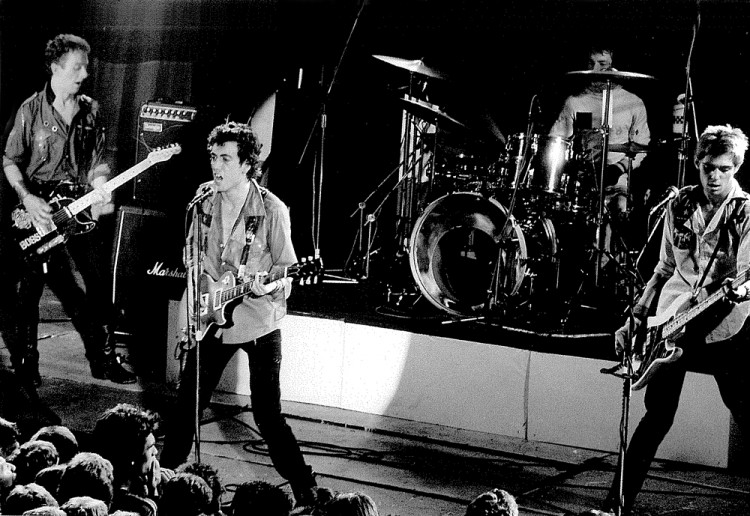 Mick Jones (left) with The Clash in the late 70s