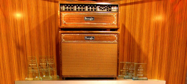 Dealer/Distributor Awards flanking an incredible Mark V head and 1x12 Extension with matching custom inlays