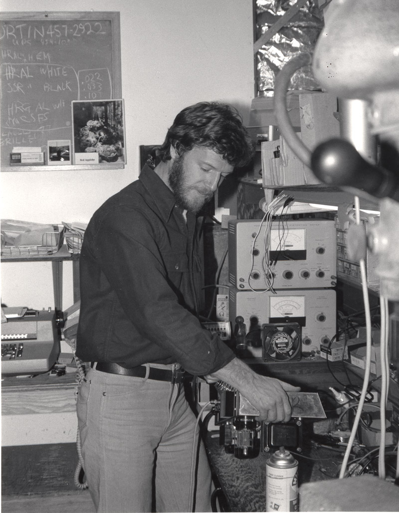 Randall Smith tech'ing a Mark I chassis on the bench in Lagunitas, California in the mid '70s